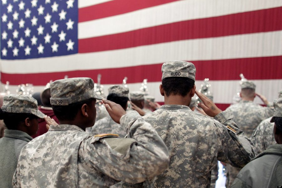 Soldiers+salute+the+U.S.+flag+during+a+recitation+of+the+Pledge+of+Allegiance+at+a+welcome+home+ceremony+for+soldiers+returning+from+a+deployment+in+Afghanistan%2C+at+Fort.+Carson%2C+Colo.%2C+Wednesday+Dec.+5%2C+2012.+Nearly+300+soldiers+of+the+4th+Brigade+Combat+Team%2C+4th+Infantry+Division%2C+returned+home+after+a+tour+of+duty+that+began+in+February.+%28AP+Photo%2FBrennan+Linsley%29